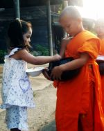 buddhist thai monk alms