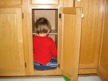 child-in-empty-cabinet