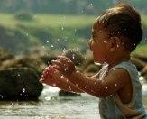 Happy kid in river