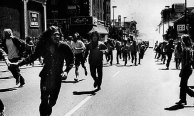 sixties protesters running