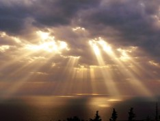 sunlight through the clouds ocean