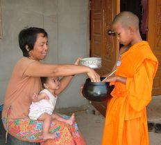 theravada monk receiving food bowl