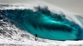 large wave with surfer