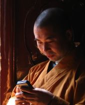 buddhist monk on phone