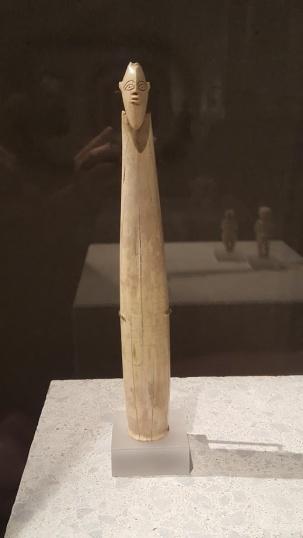 prehistoric bearded figure